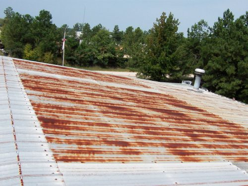 A metal roof before the restoration is started.